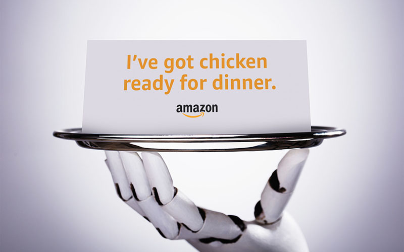 Robotic Hand Holding Blank Card In Plate On Grey Background